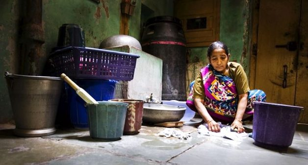 Drudgery is compounded by stigma for migrant women workers. (Photo by Bharat Patel)