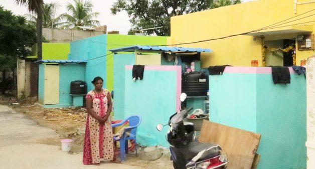 Houses in the village have been renovated after the floods. They are now powered by solar panels and have new toilets. (Photo by Jency Samuel)