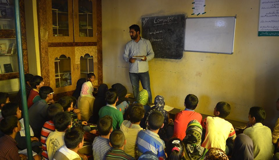 In some villages in Kashmir, educational volunteers are teaching students in community schools. (Photo by Athar Parvaiz)