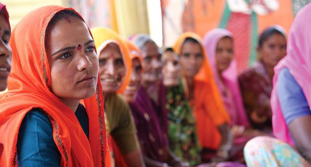 Women discussing priority issues at a village council meeting. (Photo by Ashutosh Negi)