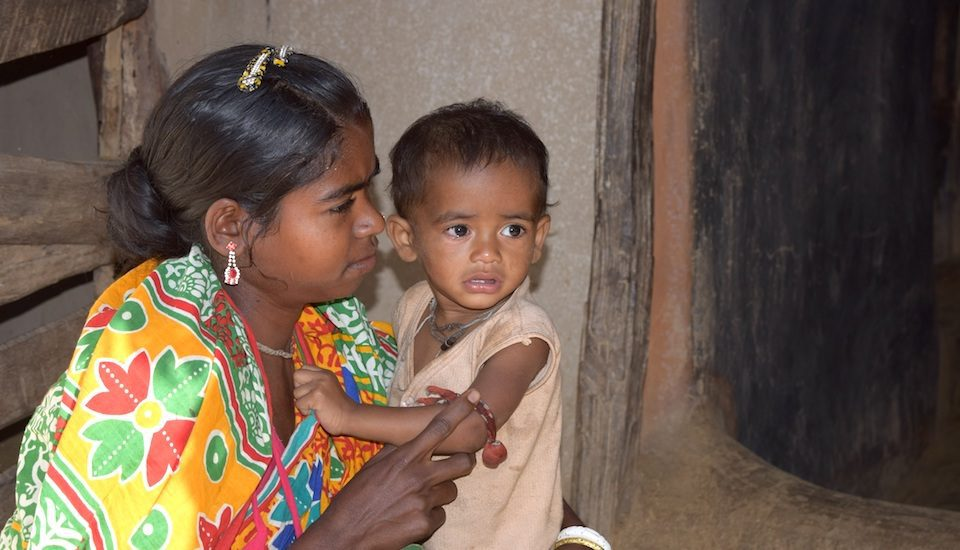 Chumudi Madkami of Palkonda village in Malkangiri with her malnourished son Aditya. (Photo by Basudev Mahapatra)