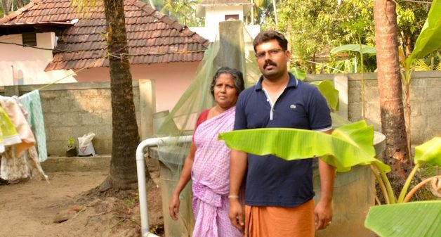 Komalam Ramachandran of Naduvilkara in Thrissur district and her son in front of the well in their house. (Photo by S. Gopikrishna Warrier)