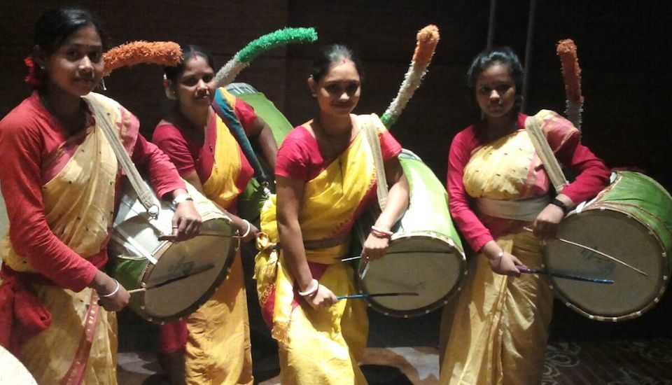Women have started playing the dhak, a big drum traditionally played only by men.