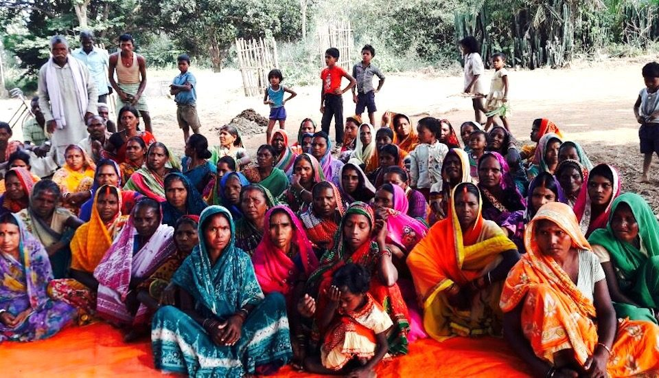 The women of Tarkhutta village holding a meeting. (Photo by Suneeta Dhar)