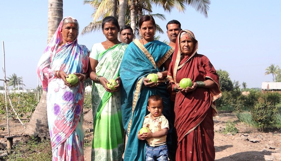 A happy VNR-Bihi grower's family in Pitkeshwar village in Pune district of Maharashtra. (Photo by VNR Nursery)