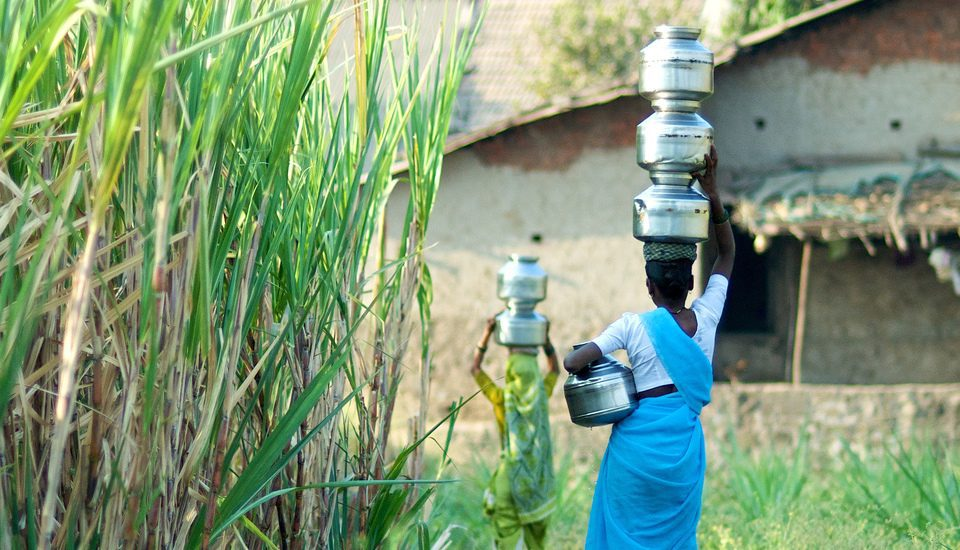 Most rural women still bathe in the open but fetch water to their homes so that their daughters can bathe comfortably. (Photo by Daniel Bachhuber)