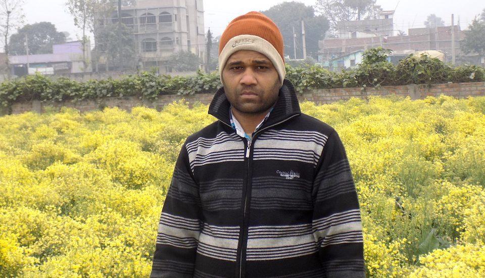 Rakesh Kumar of Chakwara village in front of his cauliflower seed farm. (Photo by Mohd Imran Khan)