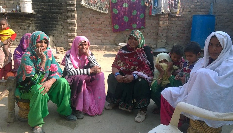 A group of village women in Nuh discusses the merits of digitizing the targeted public distribution system. (Photo by Debika Goswami)