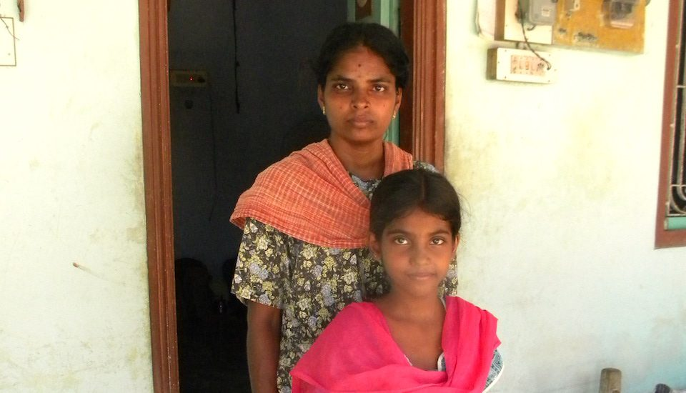 Shanti Shanmugam of Vadugapatty village says her daughter Nandana is yet to recover fully from the snakebite she received as a child. (Photo by Sharada Balasubramanian)