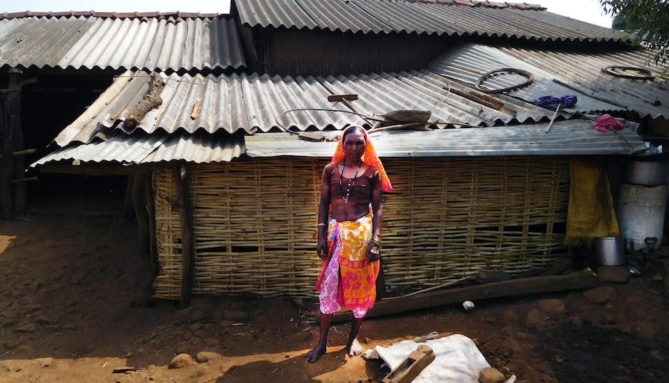 Ulusi Madhu Pawar in front of her hut in Navagam village. (Photo by Gajanan Khergamker)