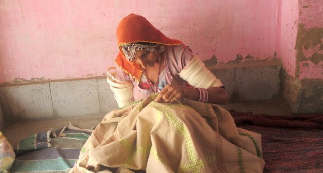 Paaro Bai of Dandkala village doing Kashida embroidery. Photo credit: Tarun Kanti Bose