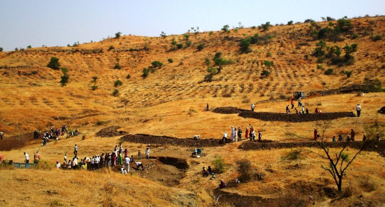 Villagers of Pawarwadi building earthen check dams and digging continuous contour trenches. It is important to work from ridge to the valley. (Photo by Nidhi Jamwal)