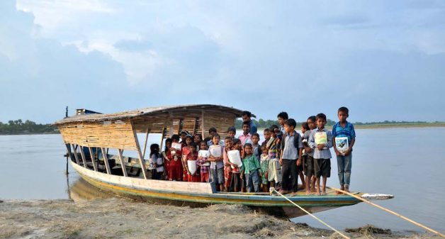 The floating school on a boat has helped children living on river islands not miss classes during the floods. (Photo by Abdul Gani)
