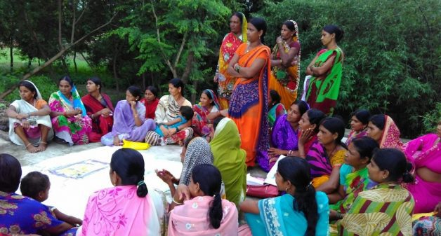A woman's meeting in Jehanabad discussing the benefits of building toilets in homes. (Photo by Mohd Imran Khan)