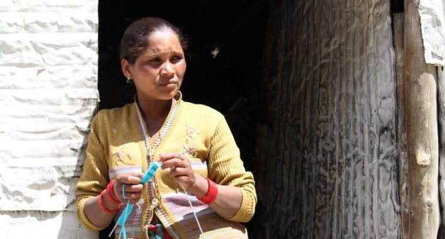 Neerja Ho from Jharkhand, seen knitting a sweater for her 4-year-old daughter, faces more problems as a woman. (Photo by Abhijit Mohanty)