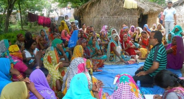 Women of Nari Sangh, the collective, hold discussions with representatives of a community-based organization about the village clinic. (Photo by Lokpriya Janhit Sewa Sansthan)