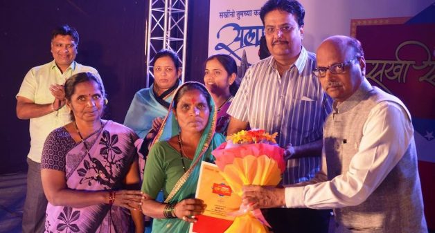 Rahibai being felicitated for her contribution in saving native crops. (Photo by MITTRA)