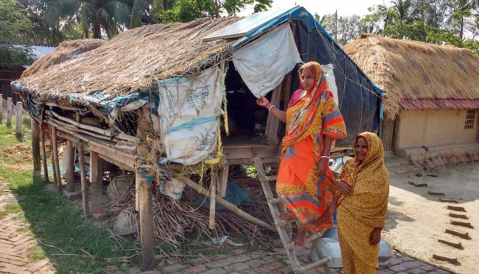Women who remain on the island after the men migrate take shelter in a stilt house during floods. (Photo by Sayanti Sengupta)