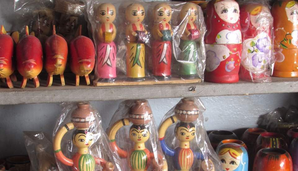 Traditional wooden dolls adorn a shelf in Channapatna. (Photo by Chithra Ajith)