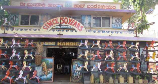 Channapatna toy factories established decades ago double up as showrooms on the road leading to the village. (Photo by Chithra Ajith)