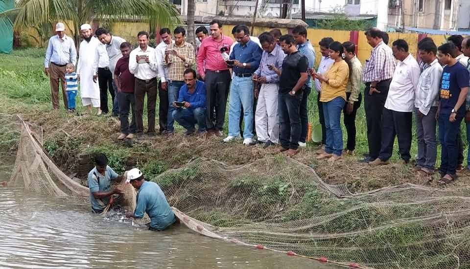 Participants at an inland fish-farming workshop watch a demonstration. (Photo by Hiren Kumar Bose)
