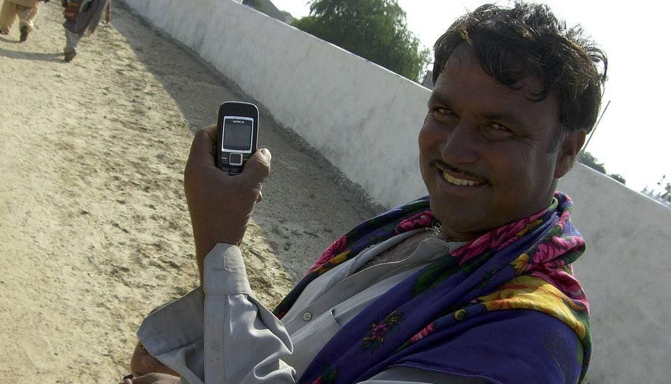Mobile phones have become ubiquitous across much of rural India (Photo by Mark Charmer)