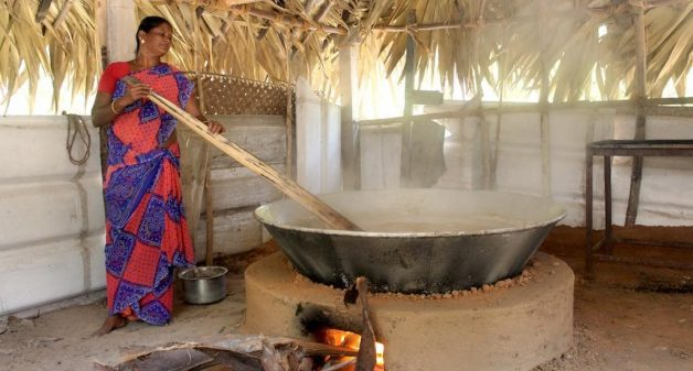 A woman boiling palm nectar, which she would continue to do for three hours, to make palm jaggery (Photo by Balasubramaniam N.)