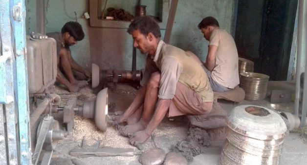 Though workers use some machines, most of the processes are manual, in the manufacturing of brass utensils. (Photo by Mohd Imran Khan)