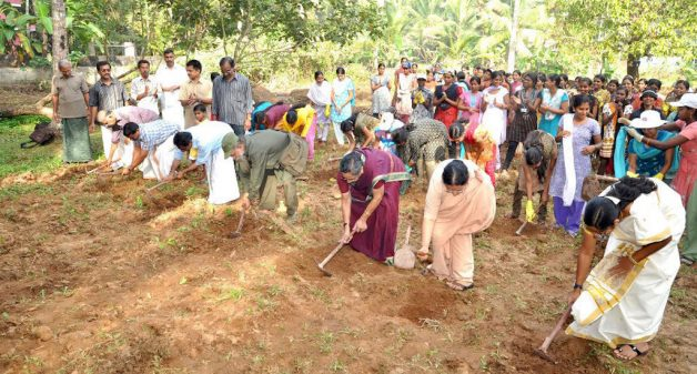 Community members prepare the ground to plant saplings (Photo by Niravu)