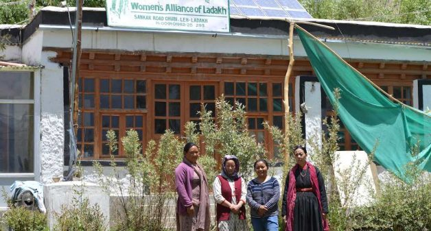 Tsering Chondol (right), President of Women's Alliance of Ladakh, with three other members outside their office in Leh (Photo by Athar Parvaiz)