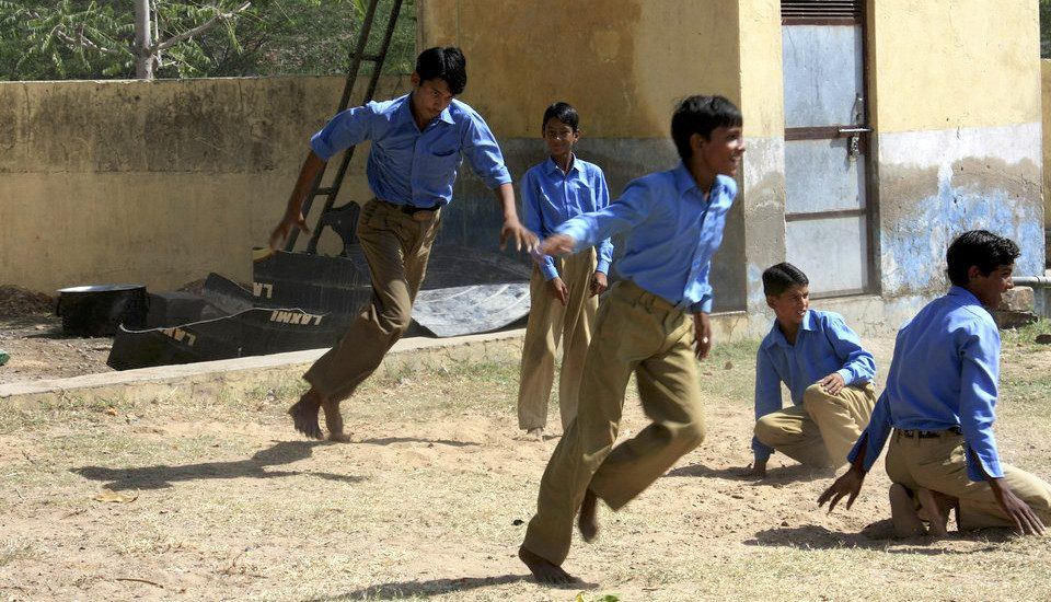 Boys playing tag in a village school (Photo by Jasper Veen)