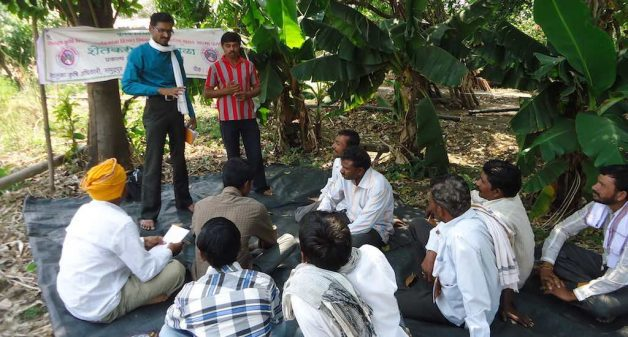 Agriculture assistant Gaydhane motivates Waigaon farmers to grow turmeric organically (Photo by Hiren Kumar Bose)