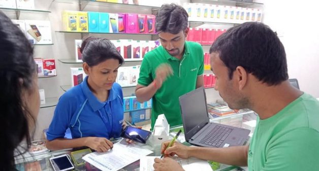 Rulina Begum selling mobile phone handsets at a company showroom (Photo by Basudev Mahapatra)