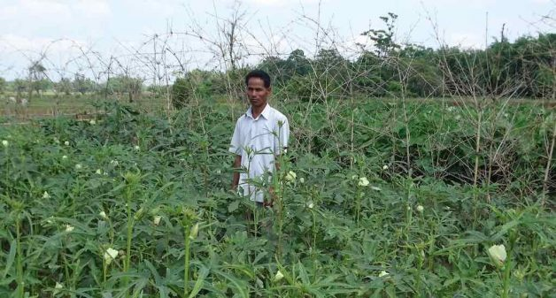 Kamal Saikia, who practises organic farming, says he finds the tips offered by Dakor Boson quite useful (Photo by Azera Parveen Rahman)