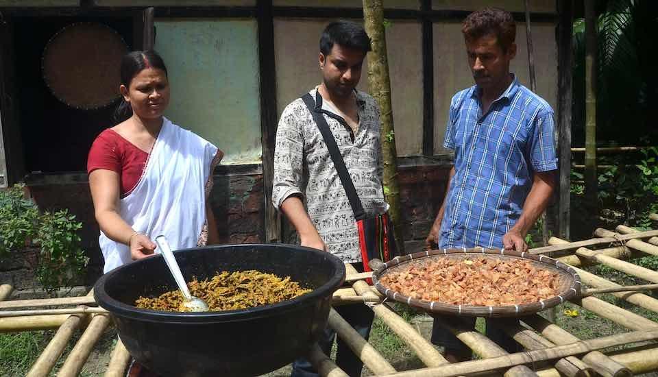 Devanga Saikia in center, guiding Utpola Bora and her husband Binanda Saikia in making pickles in their residence in Nagaon (Photo by Abdul Gani)
