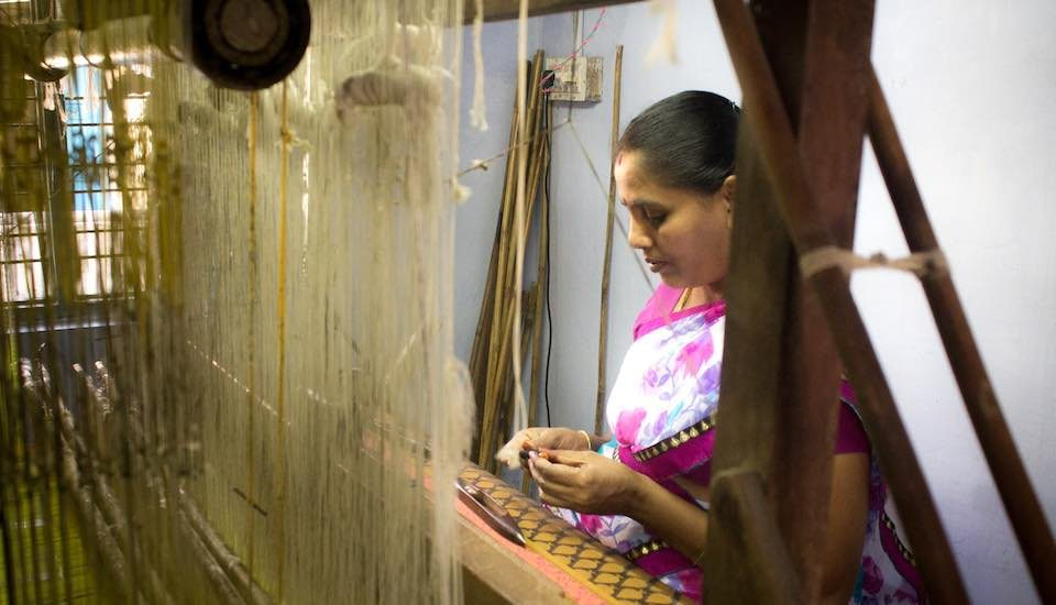 Many young people are moving away from their traditional occupation of weaving cotton sarees on handlooms (Photo by Sharada Balasubramanian)