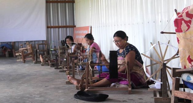 Spinning and dyeing works, integrated in the weaving unit, help the women produce traditional garments that are still in demand (Photo by Ninglun Hanghal)