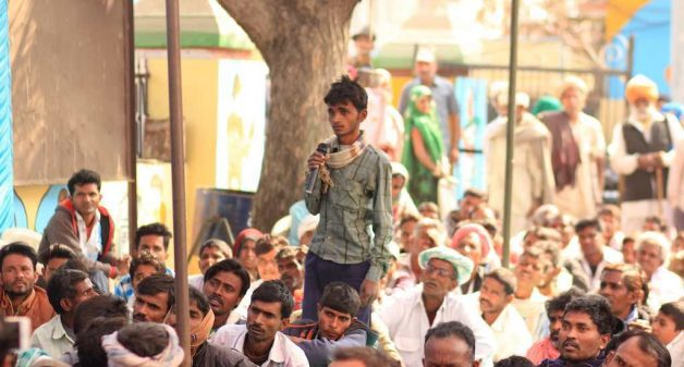 A young Silicosis patient asks a question to Justice P.C. Tatiya of Rajasthan Human Rights Commission in a public hearing organized by the Pathar Gadhai Suraksha Sangh and the Workers' Right Centre in Pindwara in December 2017 (Photo by Yuvraj Dhir)