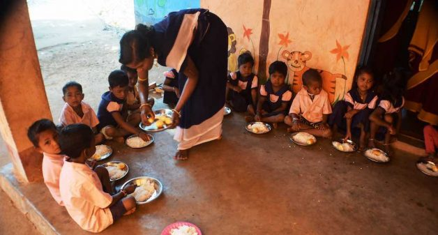 Children are served eggs at the midday meal in Devagandhana anganwadi center (Photo by Basudev Mahapatra)
