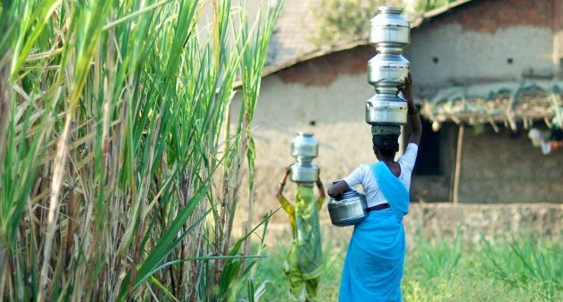 Carrying water is a constant chore for women in rural areas (Photo by Daniel Bachhuber)