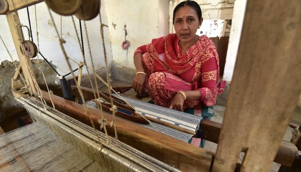 Revival of handloom has provided traditional weavers like Jaishree Habubhai of Adhoi village better livelihood (Photo by Ashish Kothari)