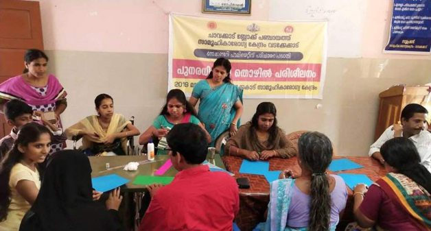Kavitha Keshavan, confined to a wheelchair, trains other physically challenged and destitute persons to make seed pens (Photo courtesy All Kerala Wheelchair Rights Federation)