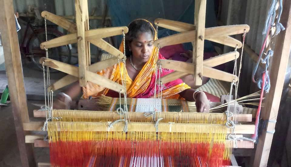 Madur artisans, most of whom are women, use a loom or a bamboo frame to weave the mats (Photo by Gurvinder Singh)