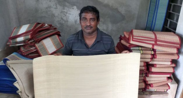 Alak Kumar Jana, an award-winning craftsman, with one of the fine quality masland mat he has woven (Photo by Gurvinder Singh)