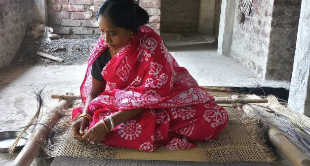 The revival of traditional floor mats has provided an improved livelihood for mat weavers like Mithu Rani Jana (Photo by Gurvinder Singh)