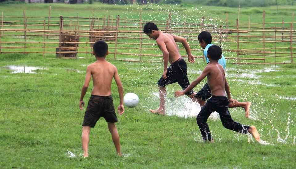A group of tribal boys playing football (Photo by Flickr)