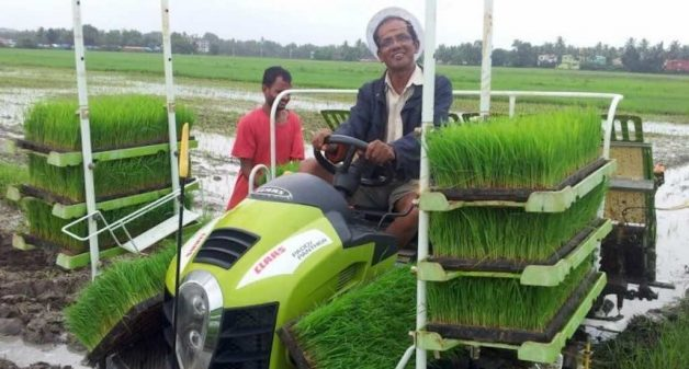 Father George Quadros on a paddy-transplanting machine (Photo courtesy goapaddy.com)