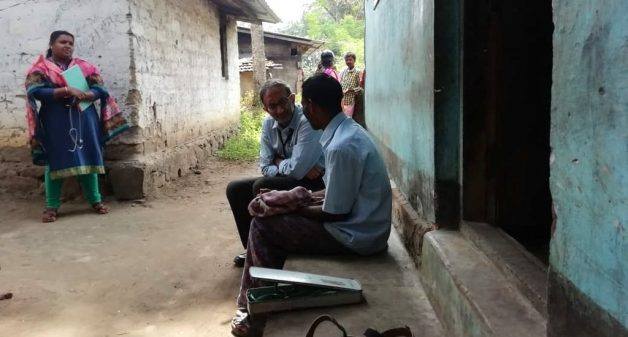 Psychiatrist Manoj Kumar interacting with a villager to diagnose the problem and issue medicine, which will be followed up by healthcare volunteers (Photo by Mental Health Action Trust)