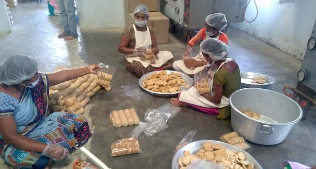 Tribal women packing millet biscuits for children of government schools at the community owned Neelamma Thalli bakery (Photo by C. Shambu Prasad)