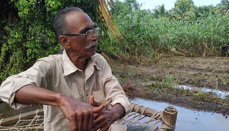 Harvesting rainwater in ponds and recharging groundwater counter the impact of salinity, helping farmers like Dhirubhai Dhudiya improve farm productivity (Photo by Tata Trusts)